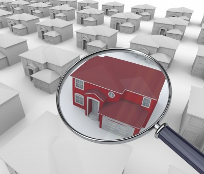 Magnifying Glass looking at home in neighborhood
